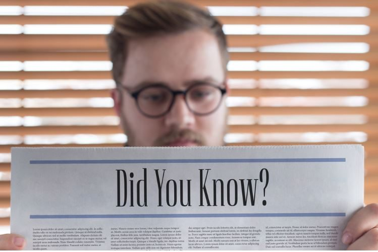 Man Reading Interesting and Weird Fun Facts