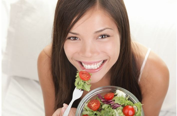 woman-with-ball-of-salad