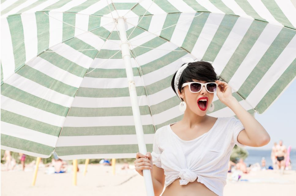 woman-holding-beach-umbrella
