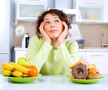 Woman Showing Her Both Unhealthy and Healthy Diet