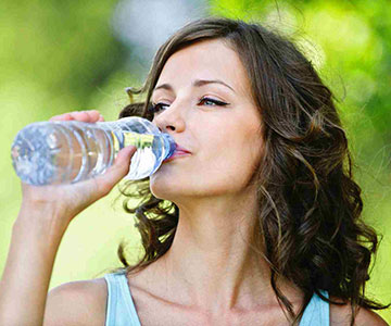 Woman Drinking Water Optimize Protein and Fiber Intake