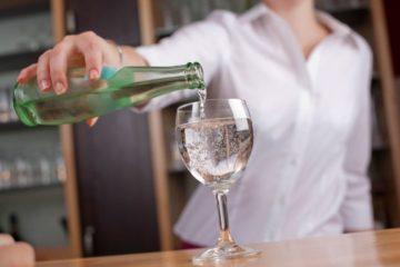 woman-pouring-mineral-water