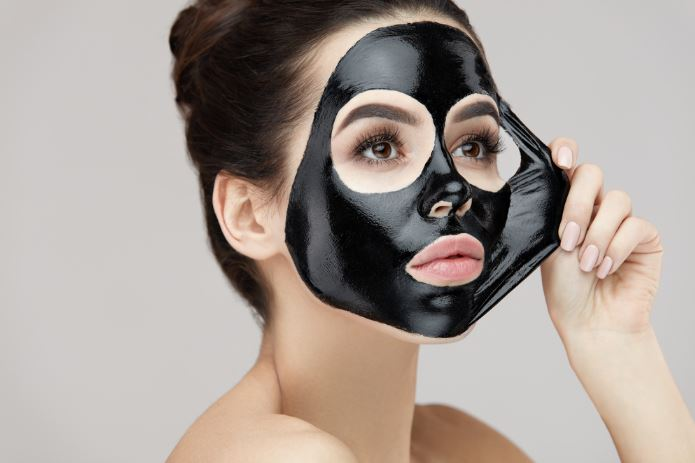 Woman Peeling Off Blackhead Mask