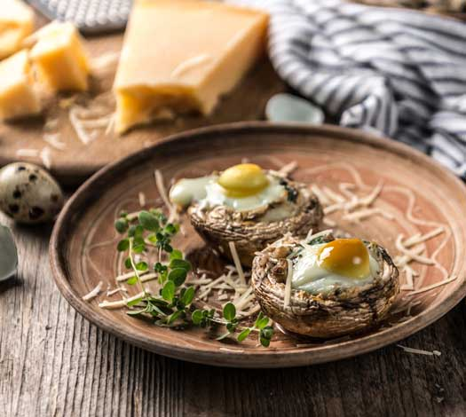 Stuffed mushrooms with quail eggs and parmesan cheese