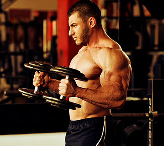 body builder lifting dumbbells