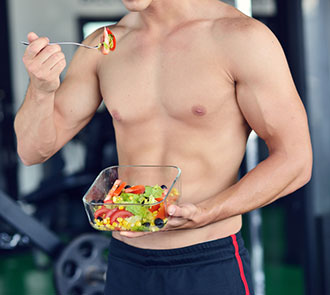 bodybuilder eating healthy foods