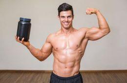 Man holding bodybuilding supplement