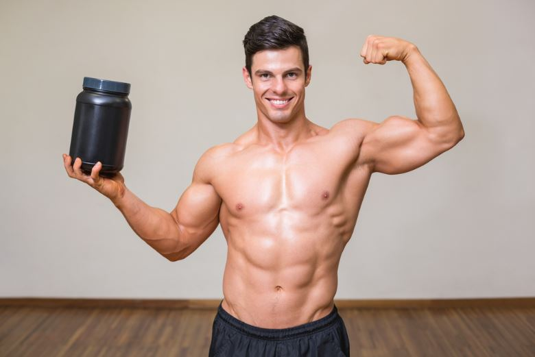 Man holding bodybuilding supplement