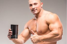 Man with bodybuilding supplement