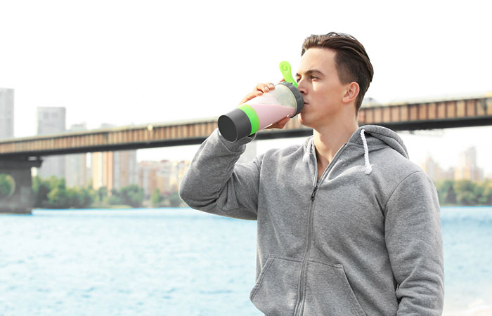 Healthy young man drinking protein shake