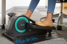 Woman using small compactable elliptical machine
