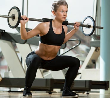 Woman doing a barbell squat