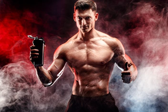 Man Holding Pre Workout Product