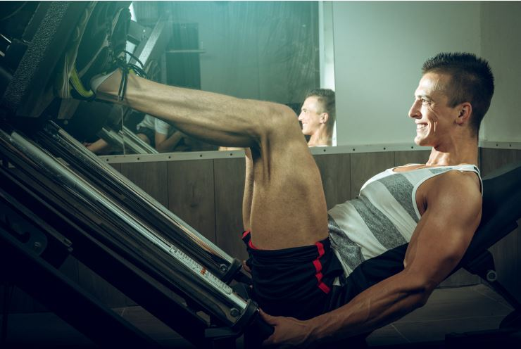 Man using a leg press machine