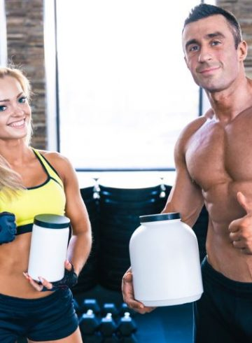 Woman and man holding pre-workout supplement