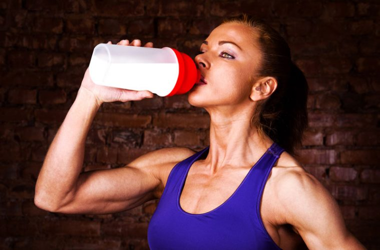 Woman Drinking pre-workout Supplement