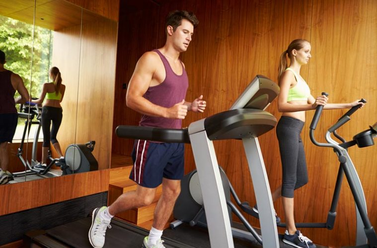 Couple Using Cardio Machine at Home