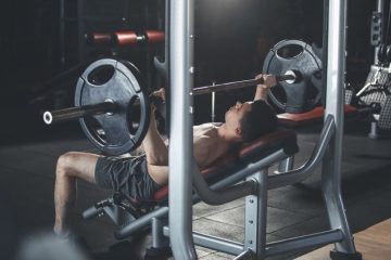 Man on a Chest Press Machine