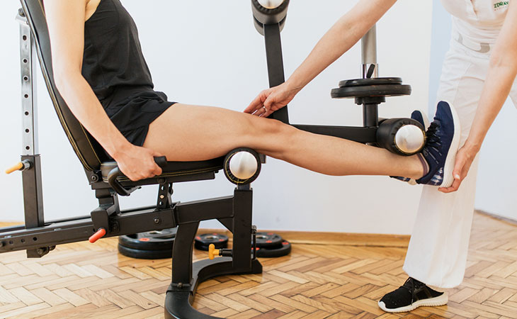 Woman Choosing Leg Extension Machine