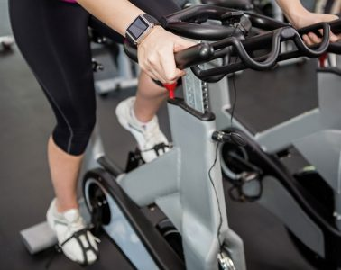 Woman Using An Exercise Bike