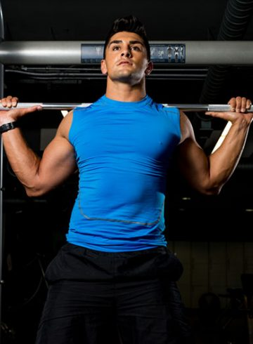 Man Lifting Weights Power Rack