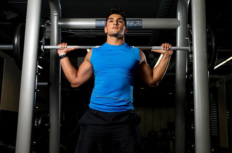 Man Lifting Weights Power Rack