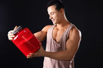 Man looking at protein powder