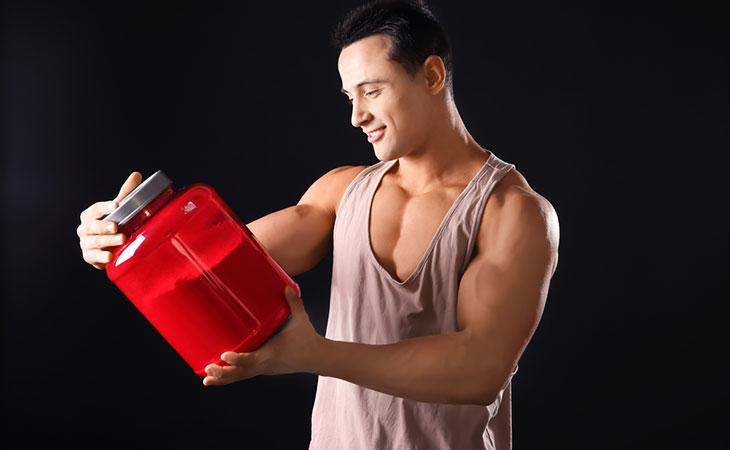 Man looking at protein powder