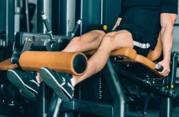 Man Using a Leg Extension Machine