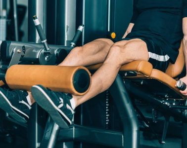 Man Using a Leg Extension Machine