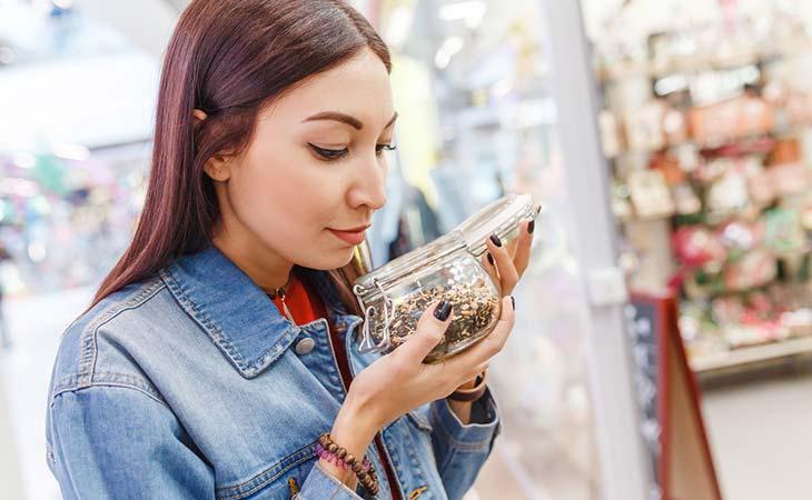 Woman choosing the best tea