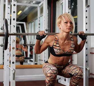 Woman Lifting Weights Power Rack