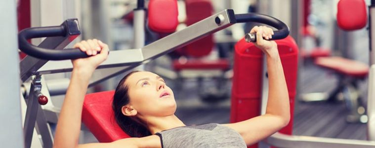 Woman using Chest Press