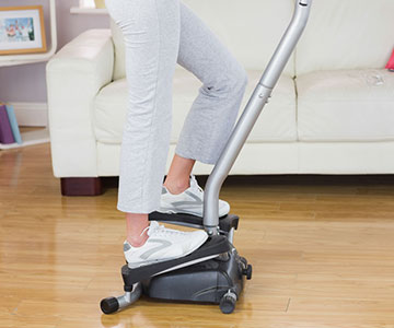 Woman Using A Stair Climber At Home
