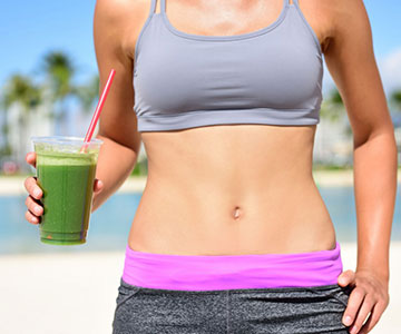 Woman Promoting Green Juice Cleanse Fad Diet