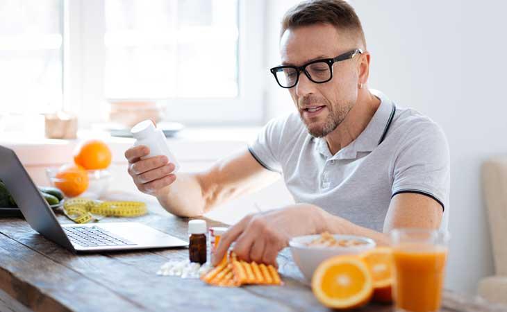 Man Choosing Appetite Suppresant Supplement