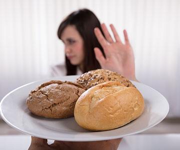 Woman On Diet Avoiding Bread