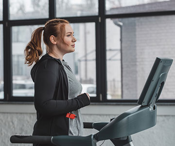 Woman Working Out In A Treadmill