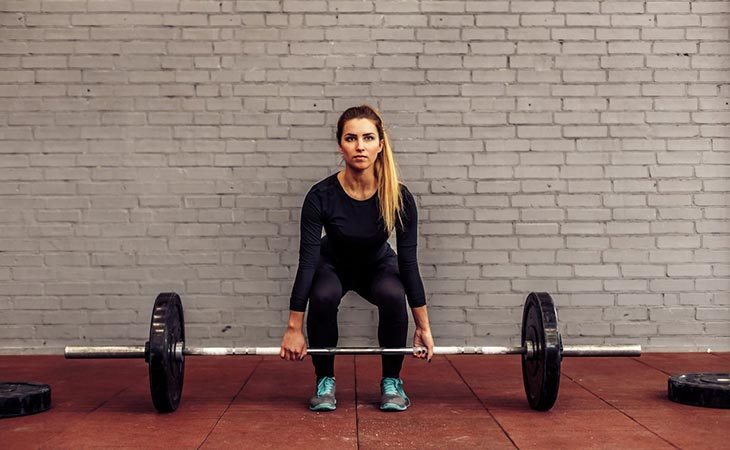 Woman Working Out Deadlift