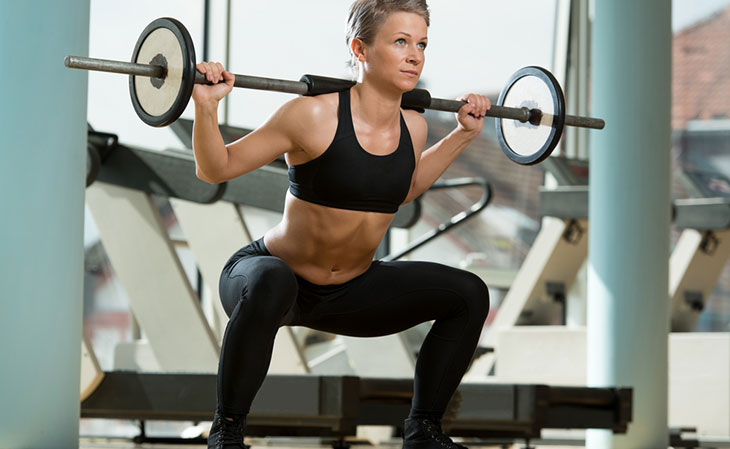 Woman Doing Barbell Squats