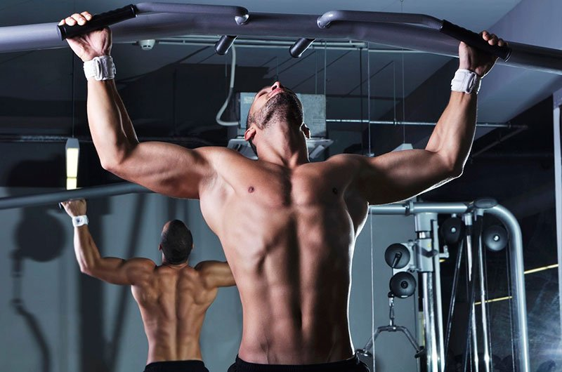 Fit Man Using Pull Up Bars Working Out