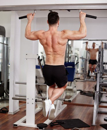 Fit Man Working Out Using A Pull Up Bar