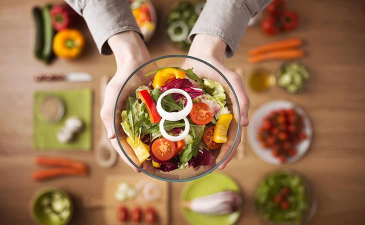 Woman Showing Healthy Meals For Health Facts