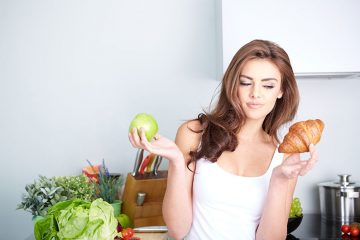 Woman Looking At Different Foods Facts Concept