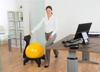 Woman doing desk exercises