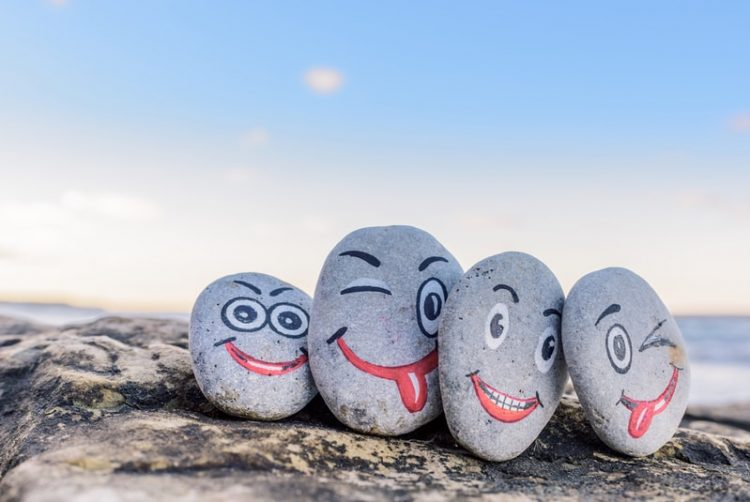 Four funny looking rocks with funny faces